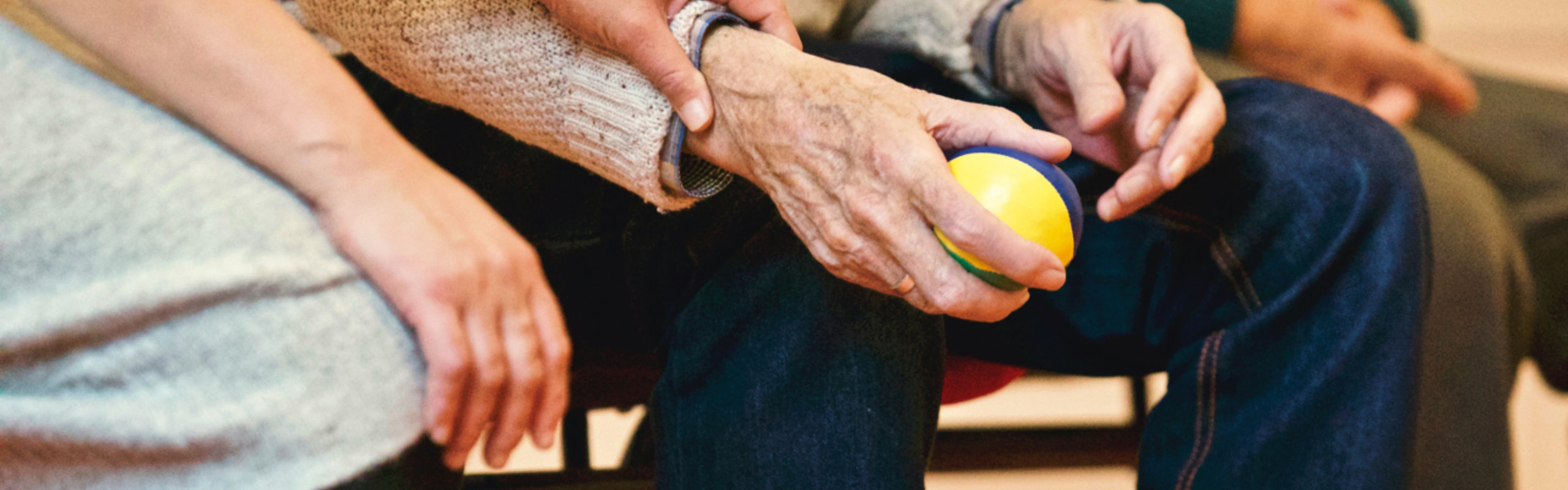 Stock photograph of a carer supporting an elderly person
