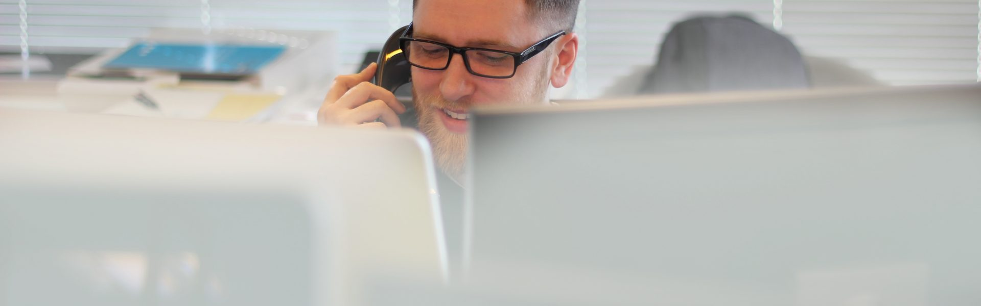 Stock photo of a man on the phone working remotely