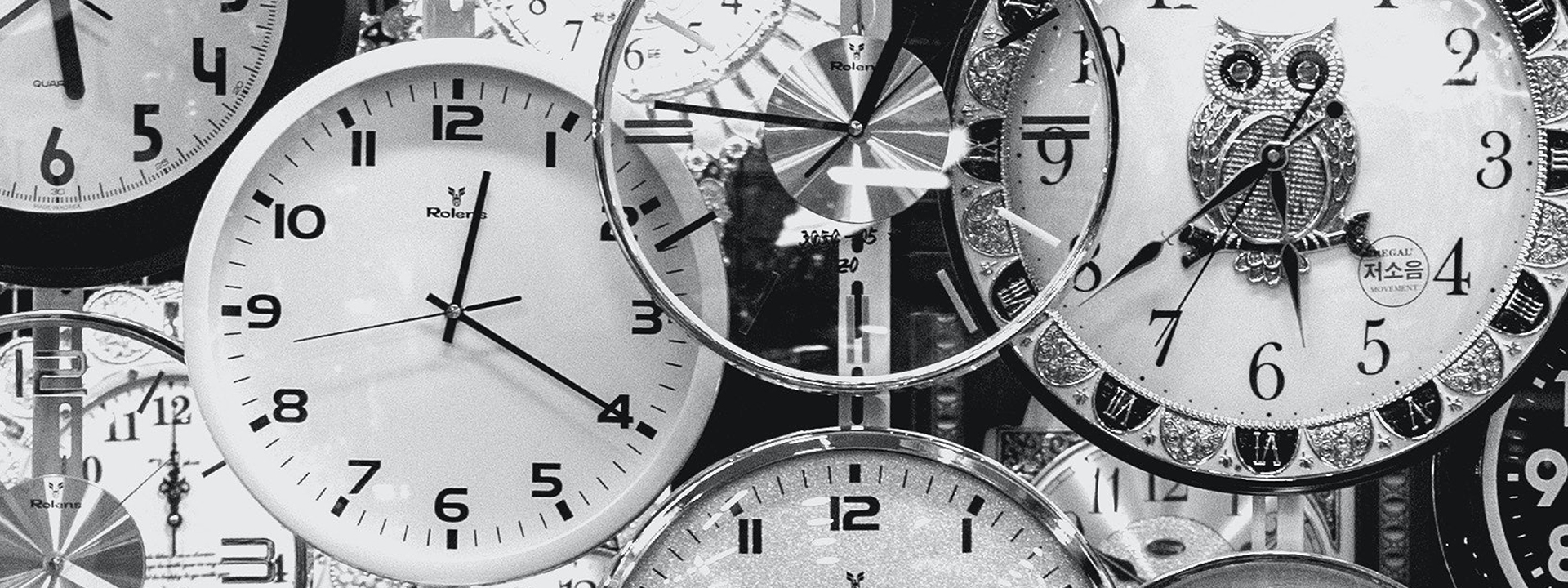 Stock photograph of multiple clocks and times