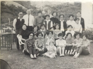 Photograph of Joy MacKeith as a child with a group of people