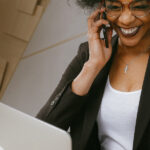 Stock photograph of a woman on the phone