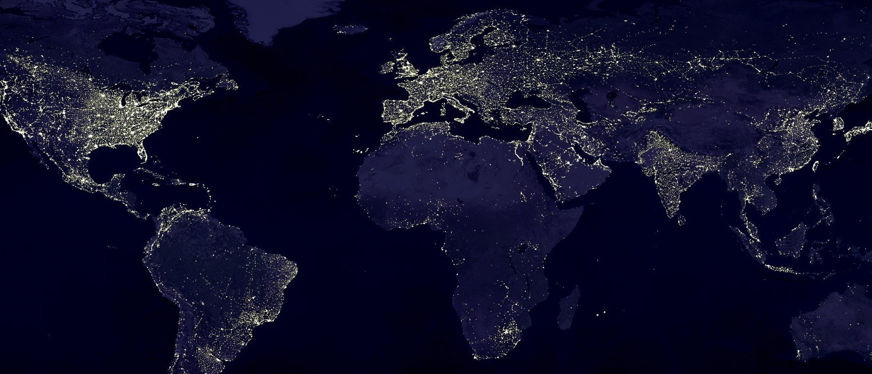 Stock photograph of a world map with lights at night