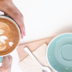 Stock photograph of a woman's hands holding a cup of coffee